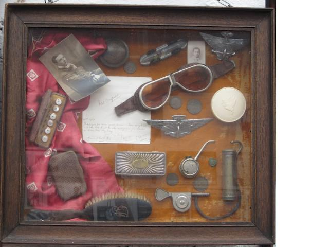 A glazed display of memorabilia relating to Pat Fairfield,
