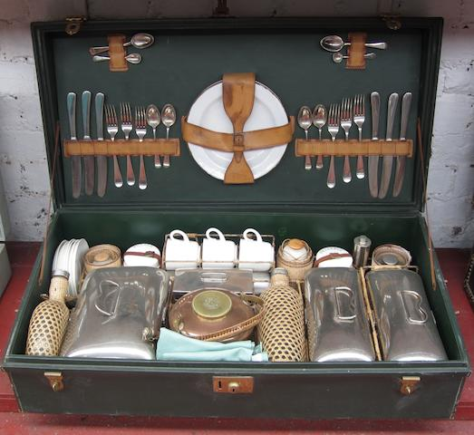 A six-person leather cased picnic set by G W Scott & Sons,