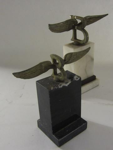 Two Bentley winged B mascots,