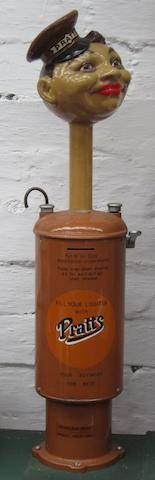 A Tommy Prattkins cigarette lighter fuel dispenser,