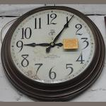 A copper clock by The International Time Recording Co. Ltd,