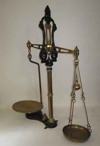 A large cast iron and brass free-standing set of scales,