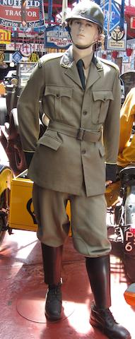 A museum display mannequin dressed as a post-War AA patrol rider,