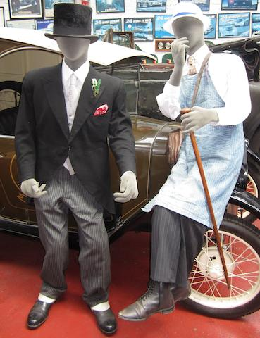 Two grey felt pose-able museum display mannequins,