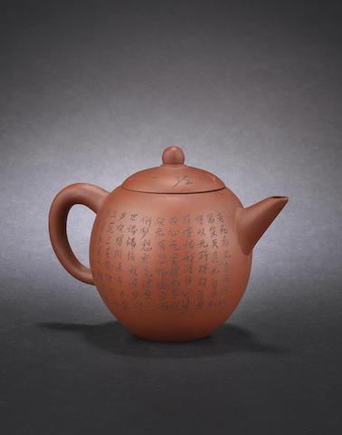 An Yixing teapot and cover Impressed maker's marks to the lid and base