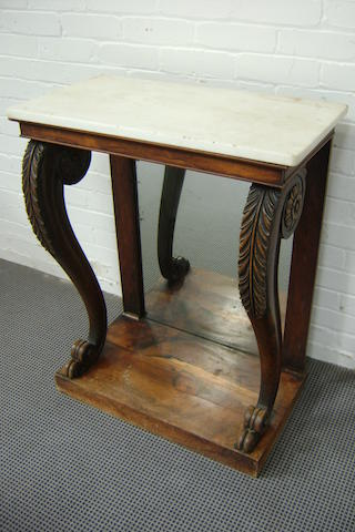 A Regency rosewood console table with mirrored back and S- Scroll supports with carved acanthus and paterae, white marble slab, 74cm wide, 93cm high, 40cm deep