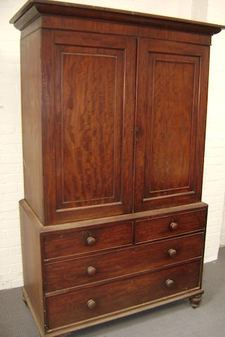 A William IV mahogany linen press the doors with fielded reserves inset with reeded mouldings on turned feet, 130cm wide, 210cm high
