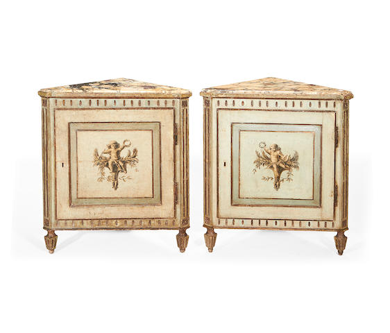 A pair of Italian 19th century pale green and grisaille decorated corner cabinets in the late 18th century style