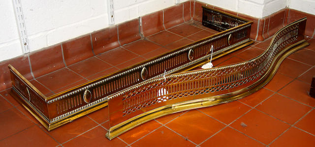 Two Regency brass fire fenders,