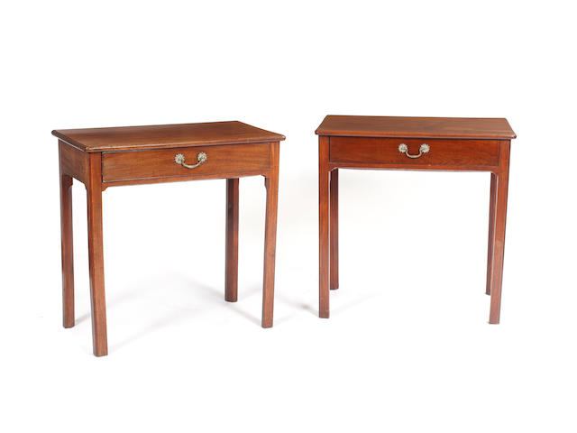 A near pair of George III mahogany single drawer side tables