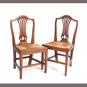 A composed set of ten George III fruitwood dining chairs