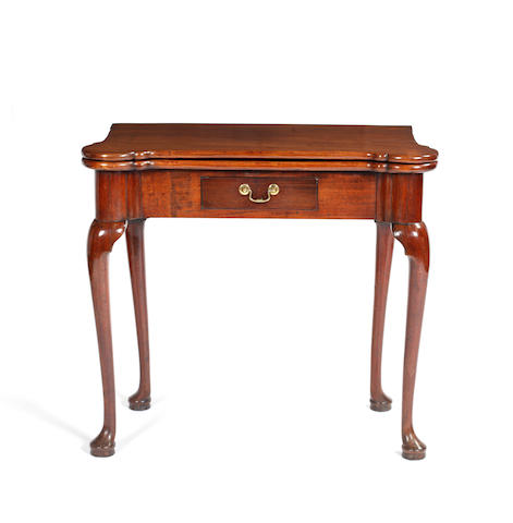 A George II walnut tea table, restored, the hinged fold-over top with outset rounded corners, later frieze drawer, on cabriole legs and pad feet, 78cm.