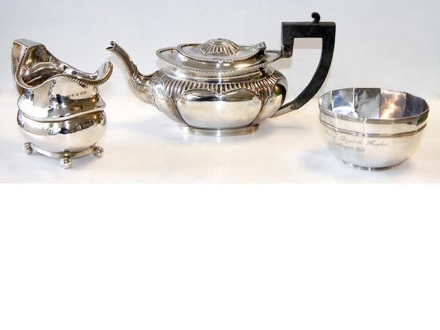 A silver tea pot,a cream jug and a silver multi faceted bowl (3).