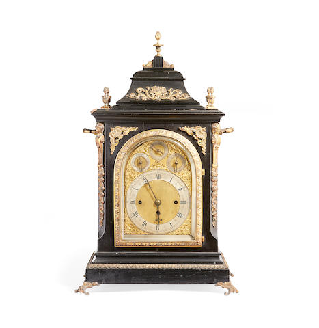 A late Victorian ebonised and gilt metal mounted quarter chiming bracket clock