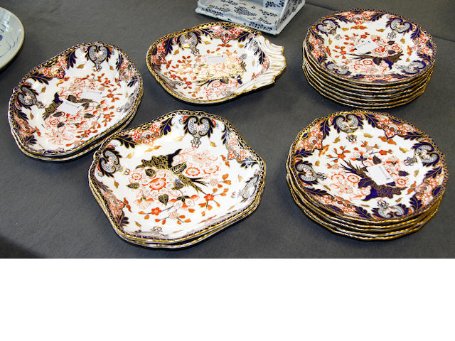 A set of twelve Royal Crown Derby plates and five serving dishes