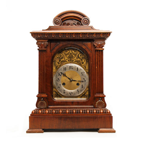 A 19th century carved walnut musical mantel clock Anonymous, probably Continental