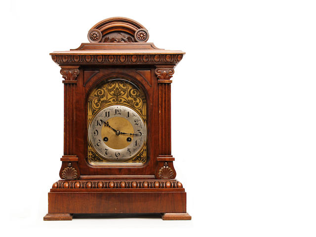 A 19th Century carved walnut musical mantel clock Anonymous, probably Continental.