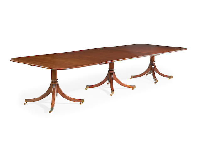 A mahogany triple pedestal extending dining table by William Tillman, in the late George III style