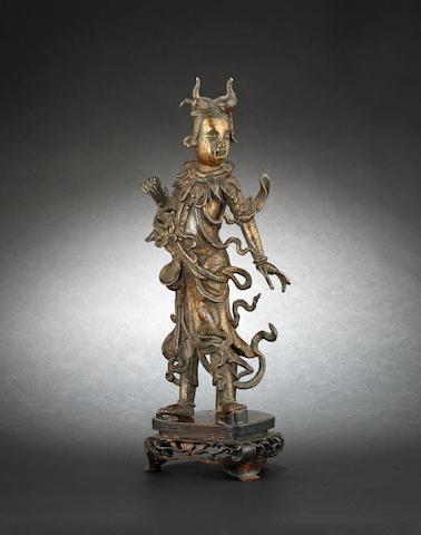 A parcel-gilt bronze figure Ming Dynasty