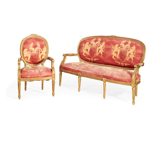 A French second quarter 20th century giltwood sofa and matching armchair in the Louis XVI style