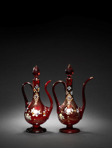 A pair red glass ewers