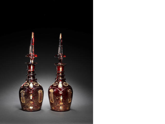 A pair of Bohemian red glass Decanters
