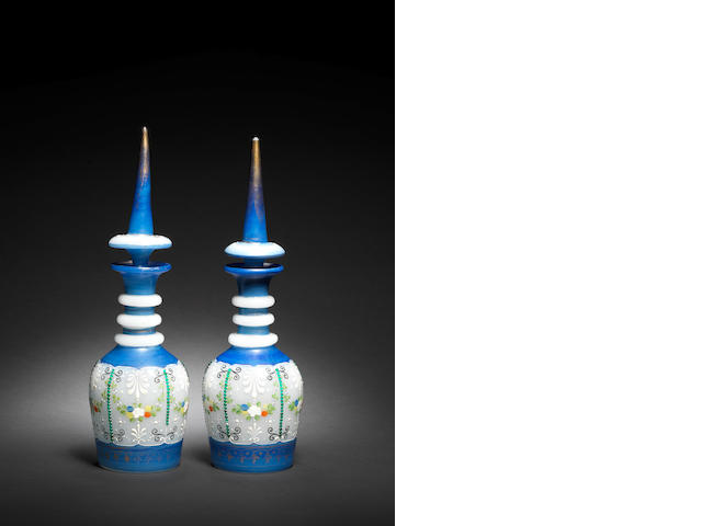A pair of Bohemian blue/white glass Decanters