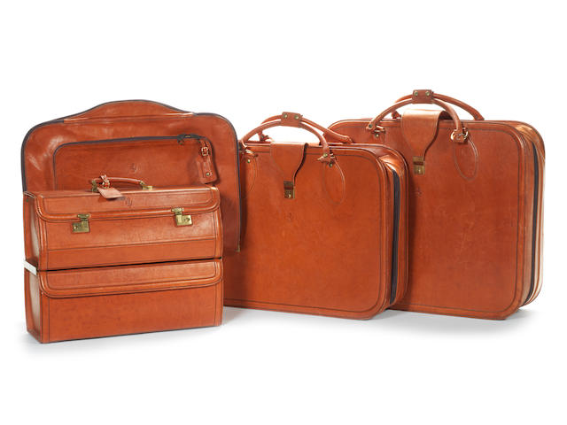 A four piece fitted leather luggage set for a Ferrari 348,
