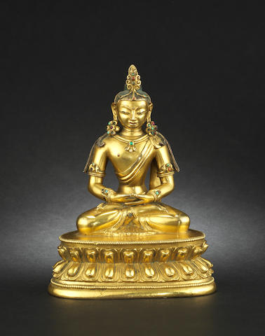A gilt bronze figure of a Buddhist Deity