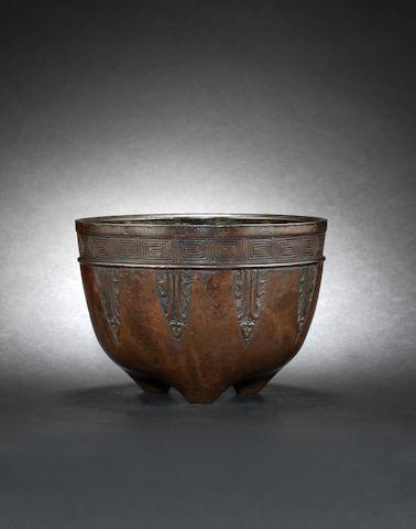 A bronze tripod bowl