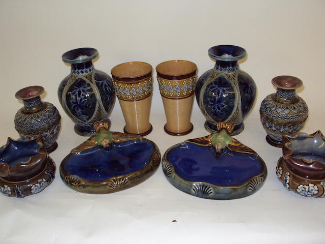 Three pairs of Doulton Lambeth vases, a pair of Doulton Lambeth beakers, and a pair of Doulton Lambeth ash trays