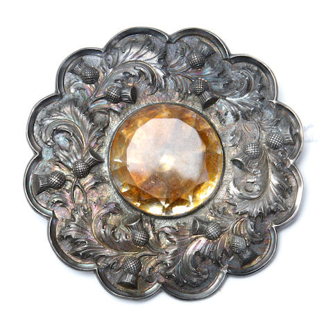 Of piping interest : A white metal mounted plaid brooch