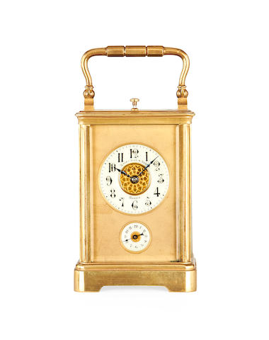 A late 19th century Swiss Petite Sonnerie brass carriage clock with repeat and alarm