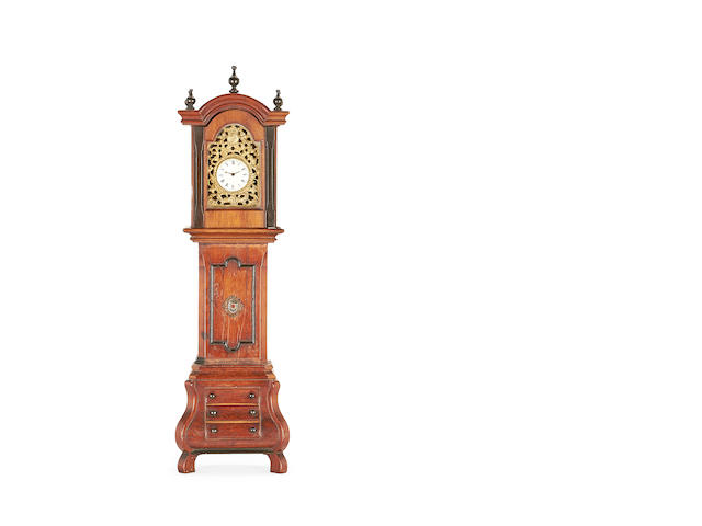 MINIATURE: A late 19th century mahogany and ebonised miniature longcase clock with an 18th century pocket watch movement the watch movement signed H. Brough Workington