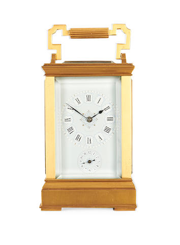 An early 20th century gilt brass carriage clock with alarm by Drocourt, retailed by Tiffany & Co.