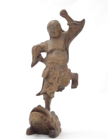 A wooden figure of Liu Hai