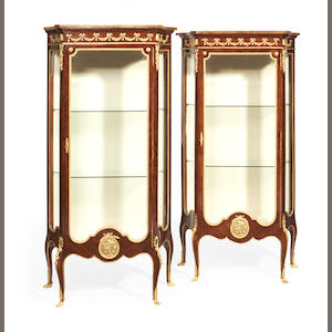 A near pair of French early 20th century gilt metal mounted vitrines in the Transitional Louis XV/XVI style