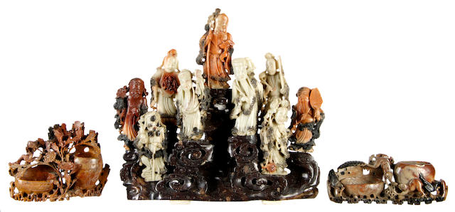 A Chinese soapstone carved figure group and two soapstone brush pots,