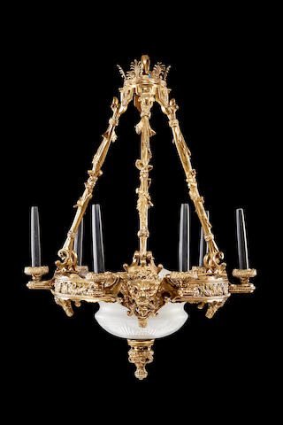 A Regency style gilt brass and frosted glass six light chandelier