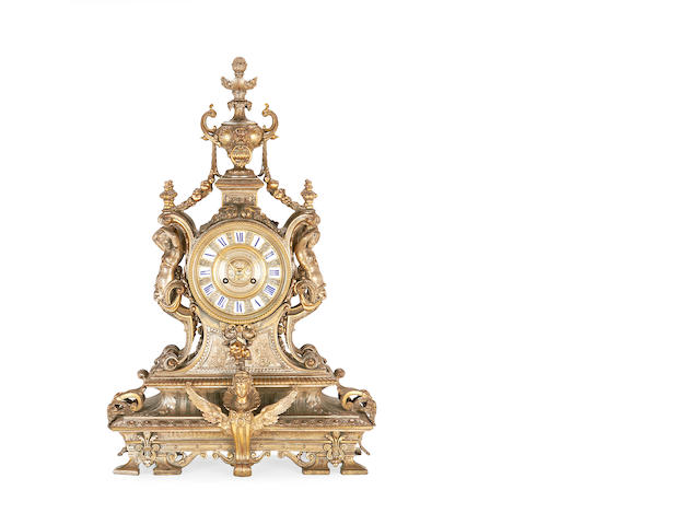 A late 19th century gilt, silvered and patinated bronze mantel clock