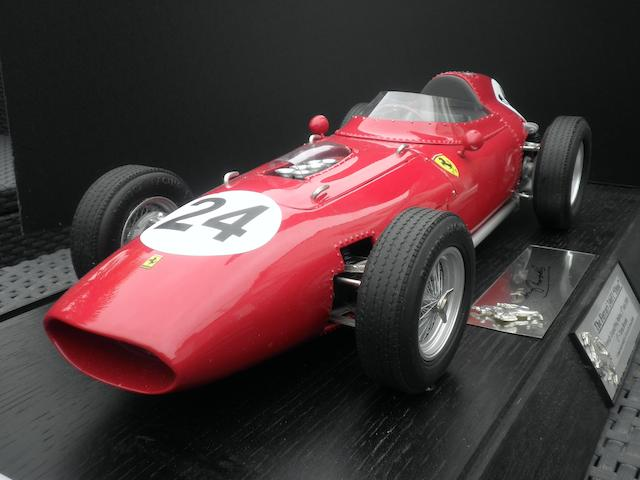 A 1:8 scale signed limited edition model of Tony Brooks' 1959 Ferrari 246F1 Dino, by Javan Smith,
