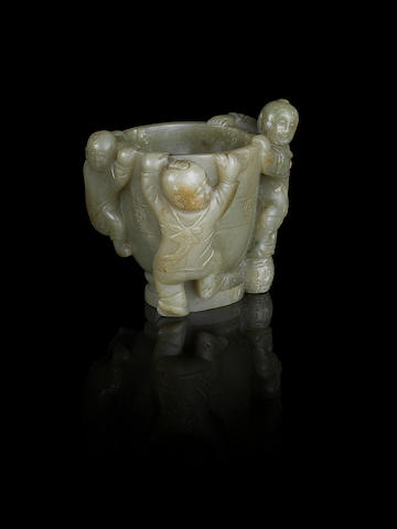 A pale green jade 'three boys' cup Ming Dynasty