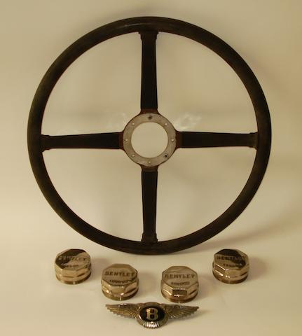 An original four spoke steering wheel for a 4¼ litre Bentley,