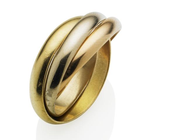 A gold trinity ring,  by les must de Cartier