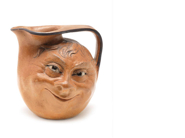 Martin Brothers A Double-sided Stoneware Face Jug, 1898