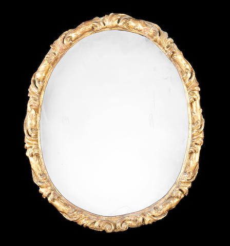 An Italian 19th century carved giltwood oval mirror