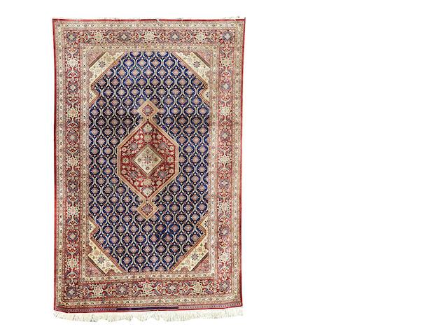 A silk Ghom rug, Central Persia, 198cm x 129cm, signed A SHOJAEFARD