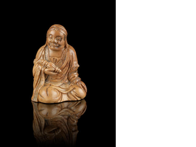 A soapstone carving of a seated figure 18th century