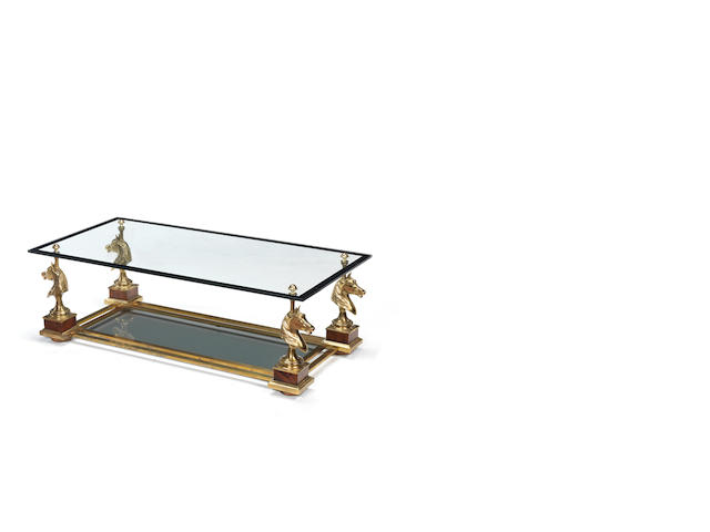 Maison Charles Coffee Table circa 1970  gilt brass and glass  41 by 120 by 60 cm. 16 1/8 by 47 1/4 by 23 5/8 in.