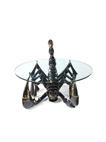 Jacques Duval-Brasseur Illuminated Scorpion Table circa 1975  gilded bronze with glass top, the tail incorporating a light fitting  Height: 76 cm.                29 15/16 in.  Diameter of top: 90 cm.                  35 7/16 in.